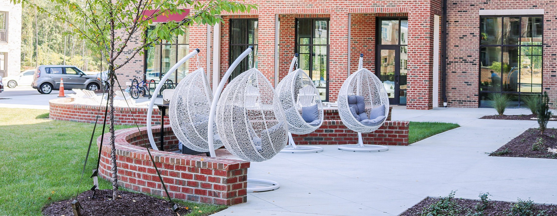 Modern hanging chairs are available in the open courtyard